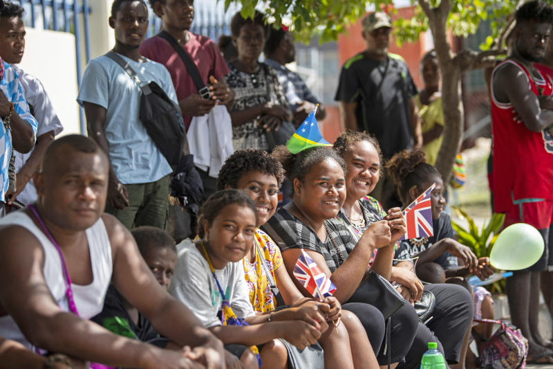 Members of the public Prince of Wales's motorcade during his royal visit to the Solomon Islands. Source: AAP