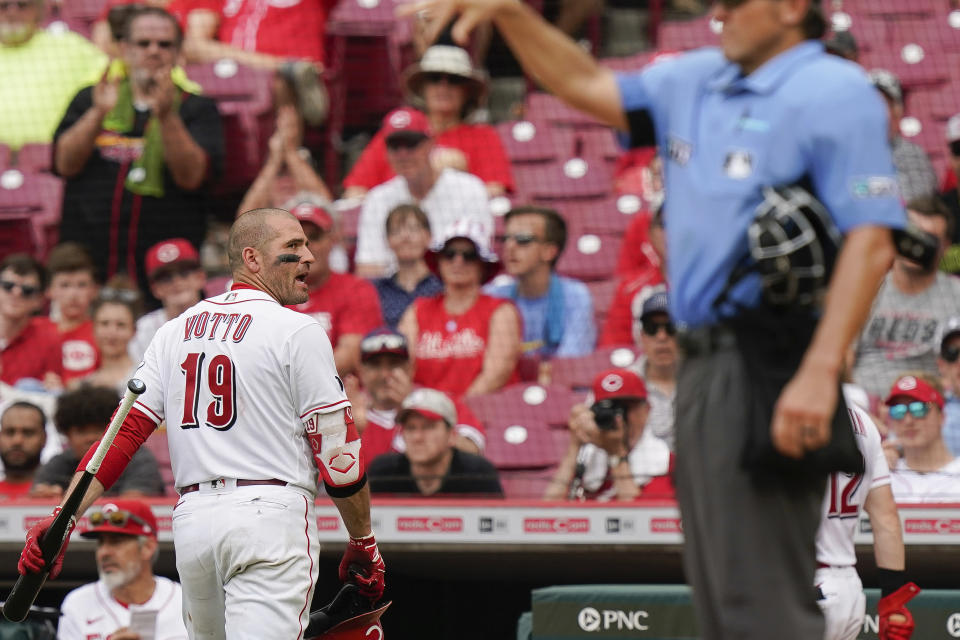 Cincinnati Reds' Joey Votto (19) looks back at the umpire during the fifth inning of a baseball game against the St. Louis Cardinals in Cincinnati, Sunday, July 25, 2021. (AP Photo/Bryan Woolston)