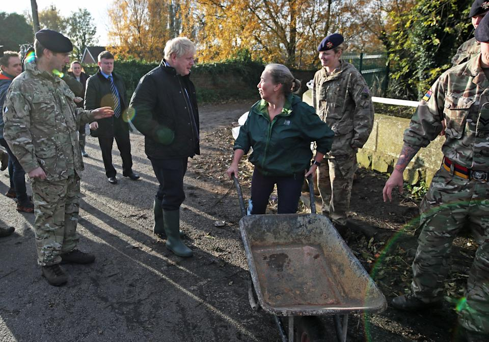 Britain's Prime Minister Boris Johnson talks to residents as he visits Stainforth near Doncaster, northern England, on November 13, 2019, following flooding caused by days of heavy rain, and the River Don bursting its banks. (Photo by Danny Lawson / POOL / AFP) (Photo by DANNY LAWSON/POOL/AFP via Getty Images)
