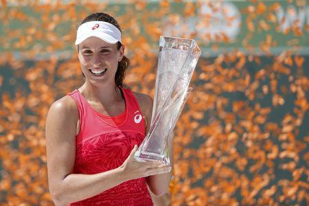 Apr 1, 2017; Key Biscayne, FL, USA; Johanna Konta of Great Britain holds the Butch Buchholz Trophy after her match against Caroline Wozniacki of Denmark (not pictured) in the women's singles championship of the 2017 Miami Open at Crandon Park Tennis Center. Konta won 6-4, 6-3. Mandatory Credit: Geoff Burke-USA TODAY Sports