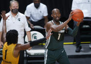Michigan State's Joshua Langford, right, looks to pass against Oakland's Rashad Williams during the second half of an NCAA college basketball game, Sunday, Dec. 13, 2020, in East Lansing, Mich. (AP Photo/Al Goldis)