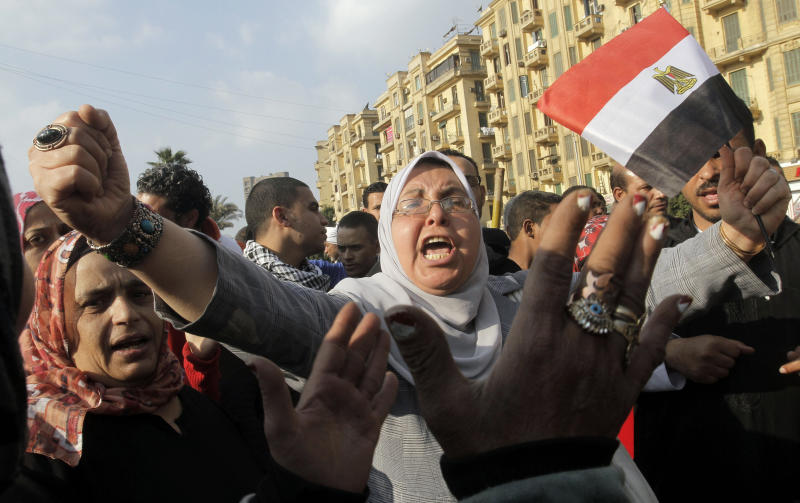An Egyptian shouts anti-Mohammed Morsi slogans as she waves an Egyptian flag during a protest at Tahrir Square, the focal point of Egyptian uprising, in Cairo, Egypt, Friday, Jan. 4, 2013. (AP Photo/Amr Nabil)