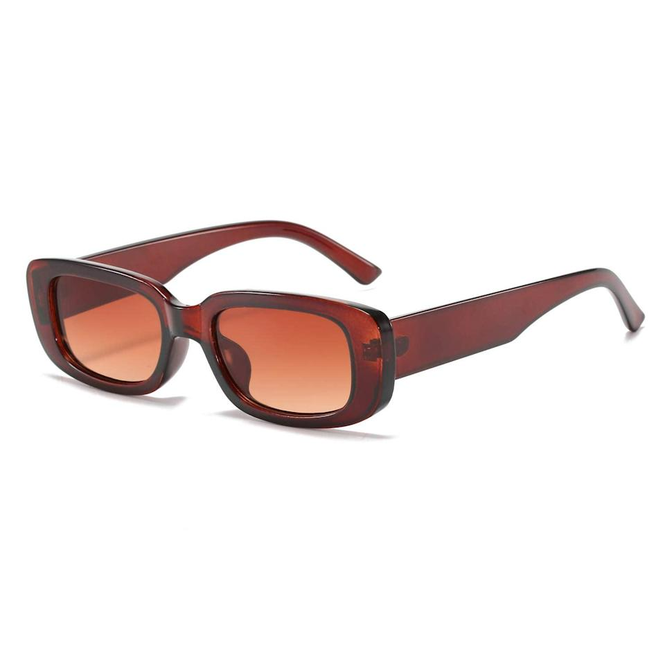 """<h2>BUTABY Clear Brown Rectangle Sunglasses</h2><br>If you are into the rectangle frames but need a more subdued neutral pair of sunglasses, this pair does the trick. <br><strong><br>The Hype:</strong> 4.6 out of 5 stars and 8,187 reviews<br><br><strong>What They Are Saying: </strong>""""Absolutely love these. They are just what I was hoping for, and I usually have a hard time with glasses as I have a narrow face. I wish I would have bought the two-pack but I wanted to be sure I liked them first. I love them!"""" - Leah <br><br><em>Shop </em><strong><em><a href=""""https://amzn.to/3gnrBtq"""" rel=""""nofollow noopener"""" target=""""_blank"""" data-ylk=""""slk:Butaby"""" class=""""link rapid-noclick-resp"""">Butaby</a></em></strong><br><br><strong>BUTABY</strong> Clear Brown Rectangle Sunglasses, $, available at <a href=""""https://www.amazon.com/BUTABY-Rectangle-Sunglasses-Driving-Protection/dp/B08MBT8P5W"""" rel=""""nofollow noopener"""" target=""""_blank"""" data-ylk=""""slk:Amazon"""" class=""""link rapid-noclick-resp"""">Amazon</a>"""