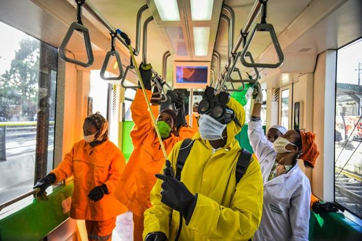 Cleaning staff disinfect a metro carriage in Addis Ababa -- Ethiopia announced its first COVID-19 deaths Sunday (AFP Photo/Michael Tewelde)