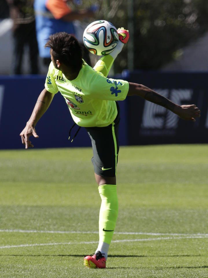 Brazil's Neymar controls the ball during a practice session at the Granja Comary training center in Teresopolis, Brazil, Friday, May 30, 2014. The 2014 World Cup begins on June 12, with Brazil and Croatia competing in the opening match. (AP Photo/Hassan Ammar)