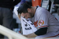 Baltimore Orioles starting pitcher Matt Harvey wipes his face with a towel in the dugout before a baseball game against his former team, the New York Mets, Wednesday, May 12, 2021, in New York. (AP Photo/Kathy Willens)