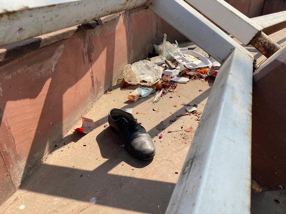 A single shoe lies amid litter at Red Fort, a day after clashes between police and protesters.