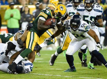 Green Bay Packers running back James Starks (44) tries to break a tackle by Seattle Seahawks linebacker Bobby Wagner (54) in the second quarter at Lambeau Field. Sep 20, 2015; Green Bay, WI, USA. Benny Sieu-USA TODAY Sports