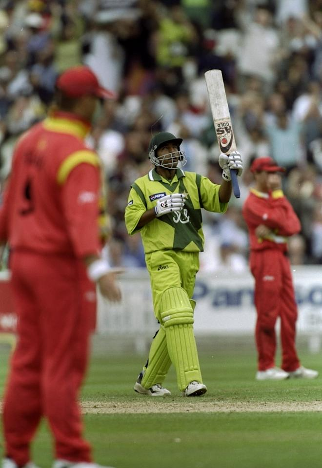11 Jun 1999:  Saeed Anwar of Pakistan reaches his century in the World Cup Super Six match against Zimbabwe at the Oval in London. Pakistan won by 148 runs.  \ Mandatory Credit: Shaun Botterill /Allsport