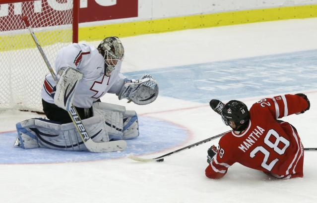 Canada's Anthony Mantha (R) is hauled down on a break-away in front of Switzerland's Melvin Nyffeler during the second period of their IIHF World Junior Championship ice hockey game in Malmo, Sweden, January 2, 2014. Matha was awarded a penalty shot. REUTERS/Alexander Demianchuk (SWEDEN - Tags: SPORT ICE HOCKEY)