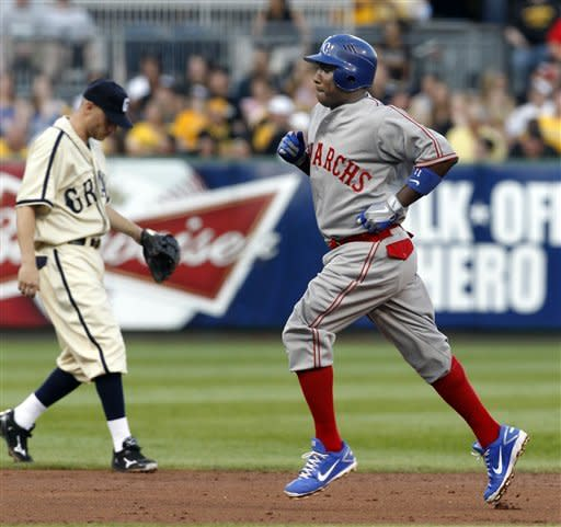 Kansas City Royals' Yuniesky Betancourt, right, rounds the bases in front of Pittsburgh Pirates shortstop Clint Barmes after hitting a two-run home run in the third inning of the baseball game on Saturday, June 9, 2012, in Pittsburgh. (AP Photo/Keith Srakocic)