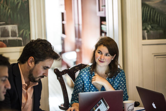 """From left, Jordan Schachtel, Alex Marlow and Julia Hahn at the """"Breitbart Embassy,"""" the nickname for their townhouse office in Washington. (Photo: Jeremy Liebman)"""