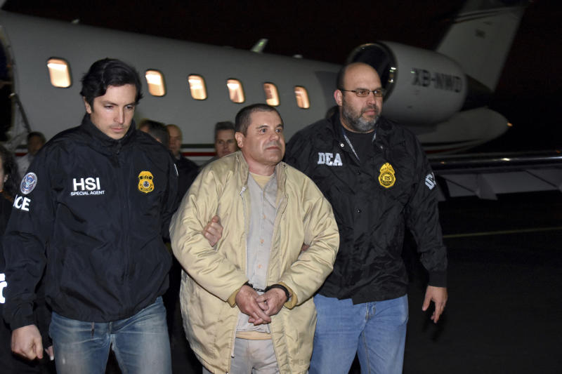 "FILE - In this Jan. 19, 2017 file photo provided U.S. law enforcement, authorities escort Joaquin ""El Chapo"" Guzman, center, from a plane to a waiting caravan of SUVs at Long Island MacArthur Airport, in Ronkonkoma, N.Y. A jury has been picked for the U.S. trial of the Mexican drug lord.  Seven women and five men were selected Wednesday, Nov. 7, 2018, as jurors in the case against Guzman. The trial is set to begin Nov. 13 with opening statements in federal court in Brooklyn. (U.S. law enforcement via AP, File)"