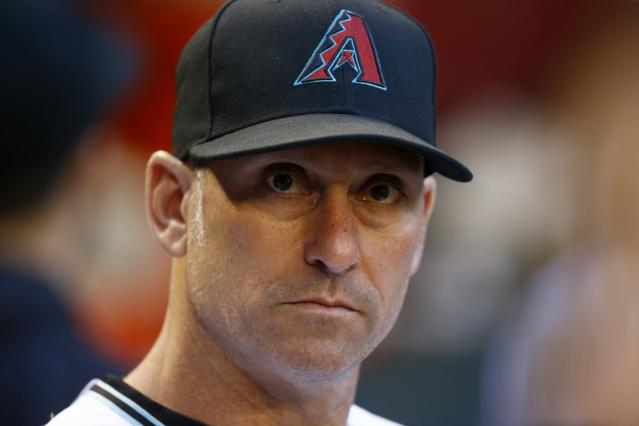 FILE - In this June 9, 2017, file photo, Arizona Diamondbacks' Torey Lovullo pauses in the dugout prior to a baseball game against the Milwaukee Brewers, in Phoenix. The Diamondbacks were one of baseballs big surprises a year ago. The surprise this year would be if they dont keep winning. ''Last year we kind of snuck up on people and had to earn their respect, said Lovullo, the National League manager of the year in his first season in the desert. (AP Photo/Ross D. Franklin, File)