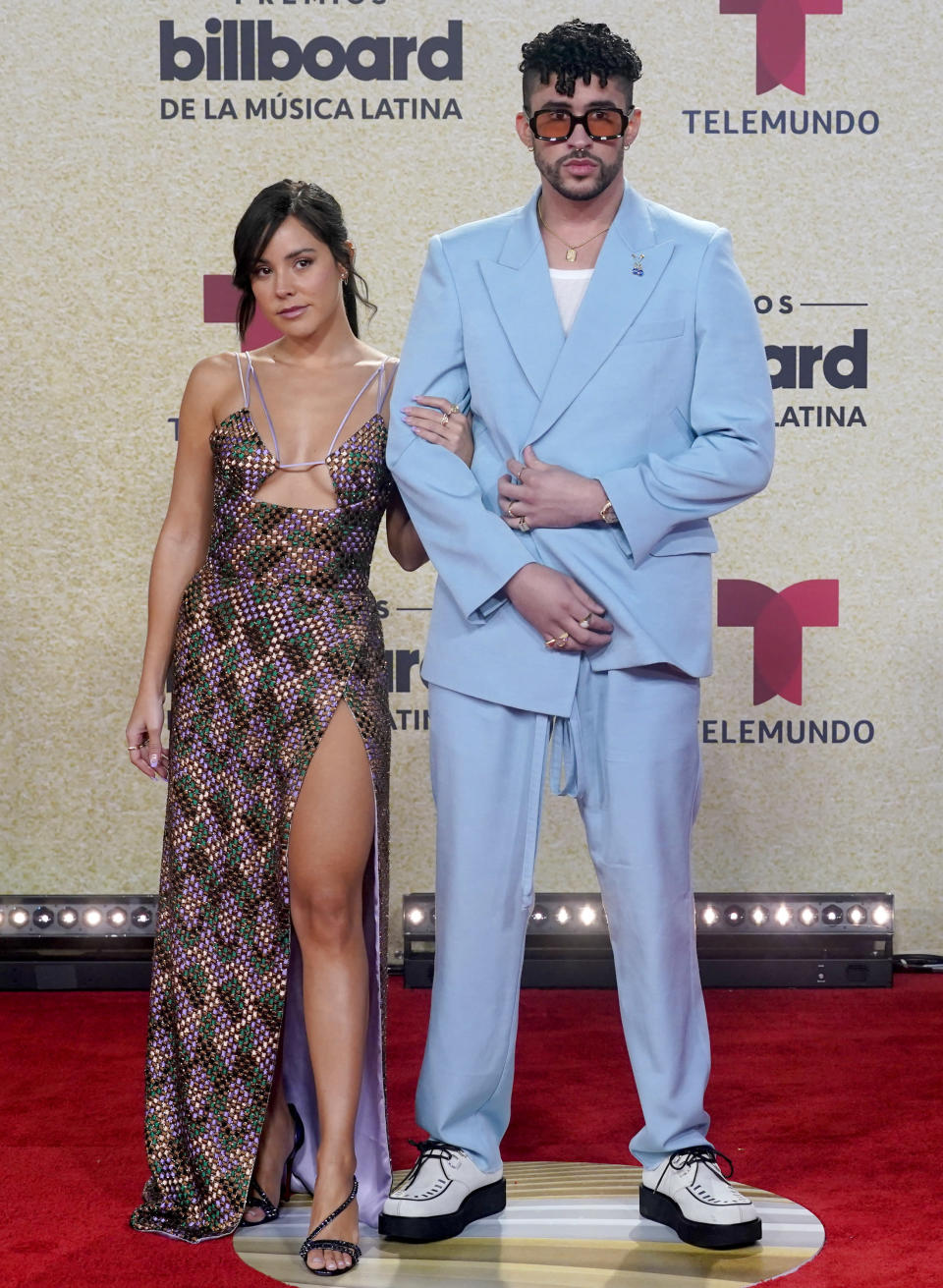 Bad Bunny, right, and Gabriela Berlingeri arrive at the Billboard Latin Music Awards on Thursday, Sept. 23, 2021, at the Watsco Center in Coral Gables, Fla. (AP Photo/Marta Lavandier)