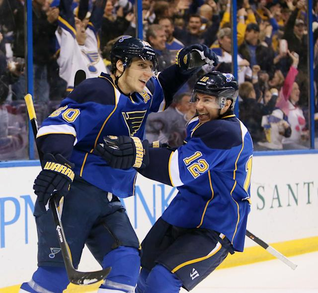 St. Louis Blues center Derek Roy, right, congratulates left wing Alexander Steen after assisting on Steen's second goal in the first period during an NHL hockey game against the Montreal Canadiens, Thursday, Dec. 19, 2013, in St. Louis. (AP Photo/St. Louis Post-Dispatch, Chris Lee)
