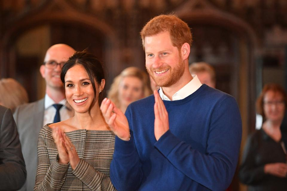 Prince Harry and Meghan Markle watch a performance during their visit to Cardiff Castle on January 18, 2018 in Cardiff, Wales.