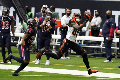 Cincinnati Bengals wide receiver Tee Higgins (85) catches a pass for a first down as Houston Texans cornerback Vernon Hargreaves III (26) defends during the first half of an NFL football game Sunday, Dec. 27, 2020, in Houston. (AP Photo/Eric Christian Smith)