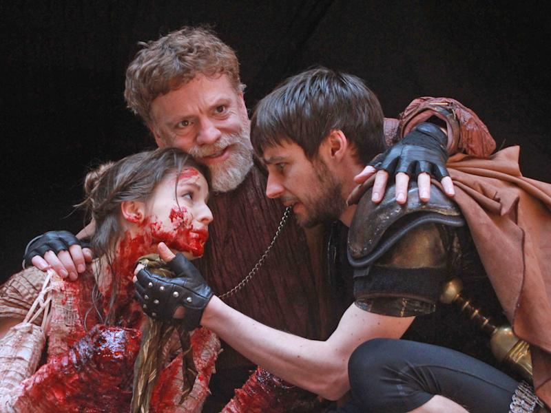 Flora Spencer-Longhurst as Lavinia, William Houston as Titus Andronicus and Dyfan Dwyfor as Lucius: Tony Larkin/Rex Features