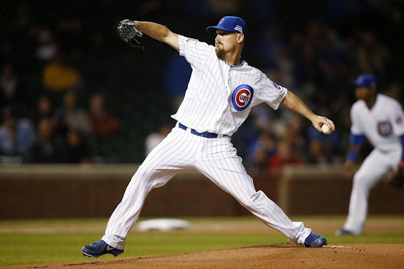 Chicago Cubs starting pitcher Travis Wood pitches against the Arizona Diamondbacks during the first inning of a baseball game on Monday, April 21, 2014, in Chicago. (AP Photo/Andrew A. Nelles)