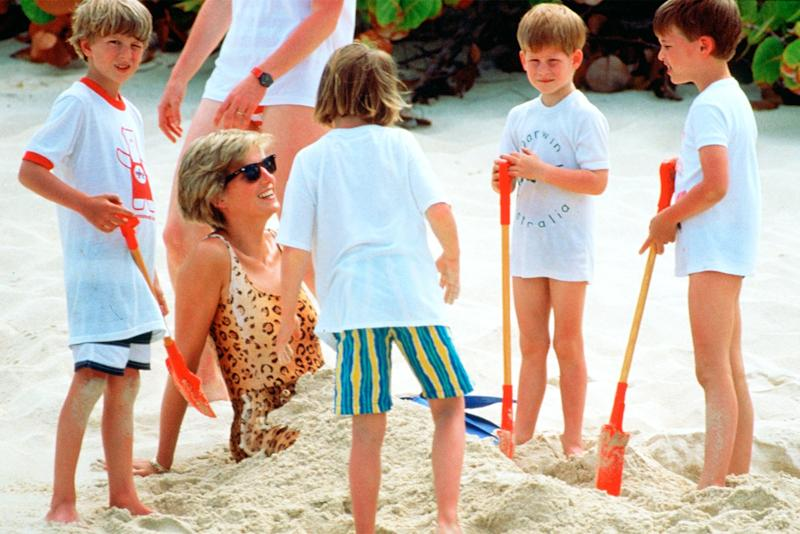 Prince Harry helps bury his mother in sand on Necker Island in the British Virgin Isles.