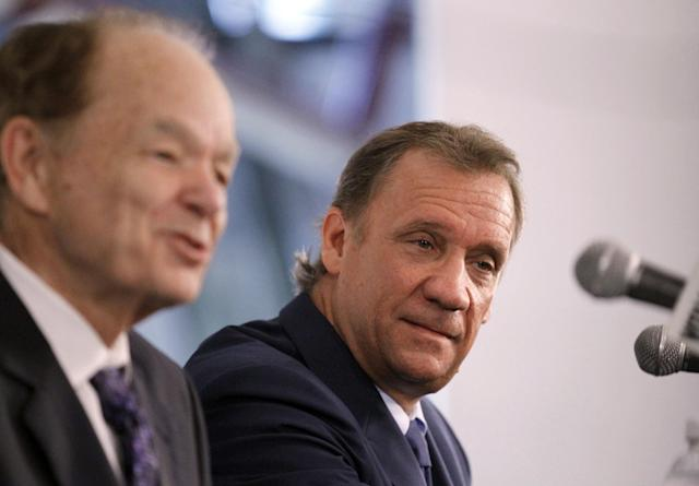 Glen Taylor (left) thinks Flip Saunders will stay on the bench next year, but maybe not beyond. (AP/Ann Heisenfelt)