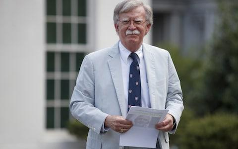 <span>John Bolton, the National Security Advisor to Trump, speaks at the White House as sources revealed Hamza had been killed</span> <span>Credit: Tom Brenner/Bloomberg </span>