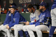 Los Angeles Dodgers' Gavin Lux, from second from left, sits on the bench with Chris Taylor and Max Muncy during Game 1 of a baseball National League Division Series against the San Francisco Giants Friday, Oct. 8, 2021, in San Francisco. (AP Photo/Jed Jacobsohn)