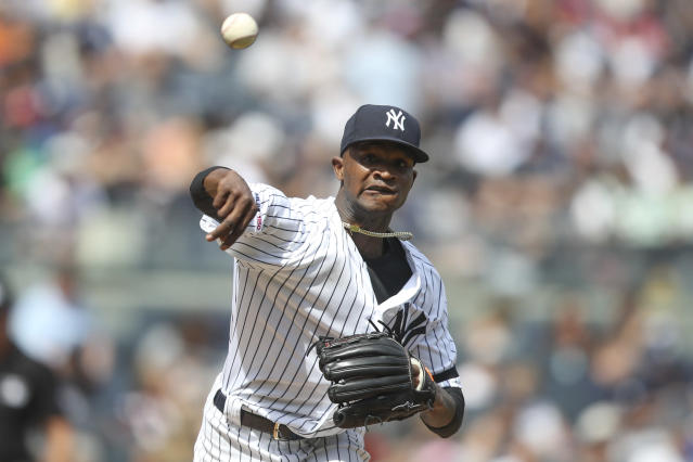 New York Yankees starting pitcher Domingo German throws to first in an attempt to pick off Oakland Athletics' Mark Canha during the fourth inning of a baseball game, Saturday, Aug. 31, 2019, in New York. (AP Photo/Mary Altaffer)