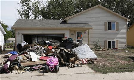 The contents of a home damaged by a flood is seen in the driveway, in Evans, Colorado September 23, 2013. REUTERS/Rick Wilking