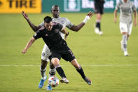 Inter Miami midfielder Lewis Morgan (7) runs with the ball as Montreal's Kamal Miller defends during the first half of an MLS soccer match Wednesday, May 12, 2021, in Fort Lauderdale, Fla. (AP Photo/Lynne Sladky)