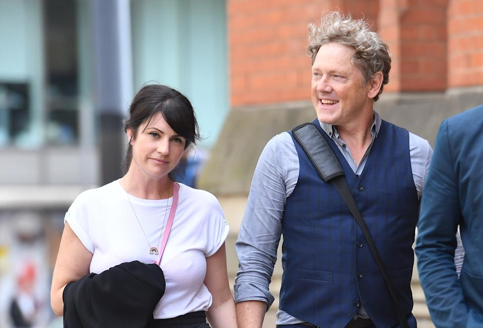 Emmerdale actor Mark Jordon and his partner Laura Norton at Manchester Minshull Street Crown Court, where he is charged with assault on a pensioner. (Photo by Jacob King/PA Images via Getty Images)