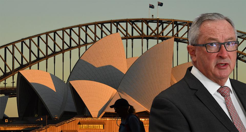 Brad Hazzard is pictured with a photo of the Sydney Opera House.