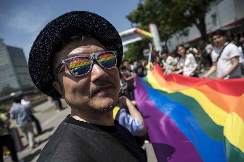 Participants march in the Tokyo Rainbow Pride parade on the streets of Tokyo, Japan May 6, 2018.