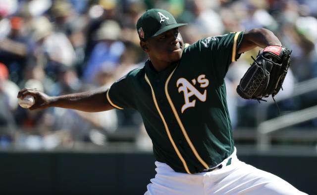 Oakland Athletics starting pitcher Jharel Cotton throws against the San Francisco Giants during the first inning of a spring baseball game in Mesa, Ariz., Monday, March 12, 2018. (AP Photo/Chris Carlson)