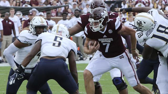 Mississippi State quarterback Nick Fitzgerald (7) is surrounded by Charleston Southern players, including linebackers Solomon Brown, left, J.D. Sosebee (5) and defensive lineman Johnny Robinson (18), during the first half of an NCAA college football game in Starkville, Miss., Saturday, Sept. 2, 2017. (AP Photo/Jim Lytle)