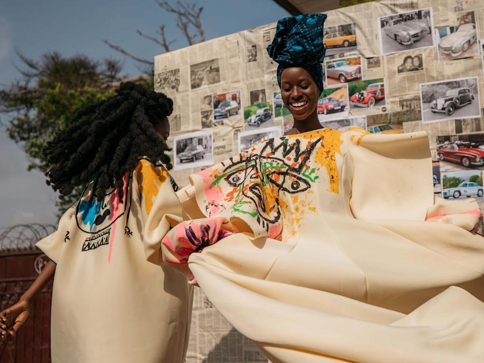 "<p>October 2020 was supposed to see the re-launch of Mercedes-Benz Fashion Week Accra, which would feature shows and presentations from the most prestigious fashion talent in Ghana. But, as with most planned events this year, the fashion week was forced to be postponed due to the global pandemic, with shows returning instead in 2021.</p><p>The organisation was still keen to celebrate Ghanian fashion though as part of its efforts to support global fashion talent and spotlight emerging designers. So, in lieu of shows, Mercedes-Benz worked with a local team in Accra, including photographer Carlos Idun-Tawiah, to create a powerful photographic campaign which highlights the design talent the country has to offer, shooting the beautiful collections on the vibrant streets of the capital.</p><p>""Aspirational design is at the heart of the Mercedes-Benz brand, and our commitment to supporting global talent who push creative conversation forward is more important than ever,"" said Bettina Fetzer, vice president of marketing at Mercedes-Benz. "" The level of talent in Ghana is truly inspiring and we are excited to kick-start planning to re-launch Mercedes-Benz Fashion Week Accra, when it is safe to do so.""</p><p>The concept of the shoot centred around how, historically in Ghana, skills and lessons are transferred through the generations, allowing for plenty of opportunity for collaboration between designers and other creatives of every age. Idun-Tawiah shot the work of Larry Jay, Steve French, Hazza, Atto Tetteh and Chloe Asaam, where each designer had the opportunity to tell their story of how intergenerational collaboration has informed their creative practice.</p><p>Scroll down to see highlights of the shoot from the five designers profiled – and look out for the return of Mercedes-Benz Fashion Week Accra in 2021, which you will be able to follow <a href=""https://www.instagram.com/mercedesbenzfashion/"" rel=""nofollow noopener"" target=""_blank"" data-ylk=""slk:here"" class=""link rapid-noclick-resp"">here</a>.</p>"