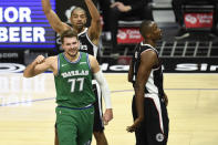 Dallas Mavericks guard Luka Doncic, bottom left, reacts after drawing a foul during the first half of an NBA basketball game against the Dallas Mavericks in Los Angeles, Sunday, Dec. 27, 2020. (AP Photo/Kyusung Gong)