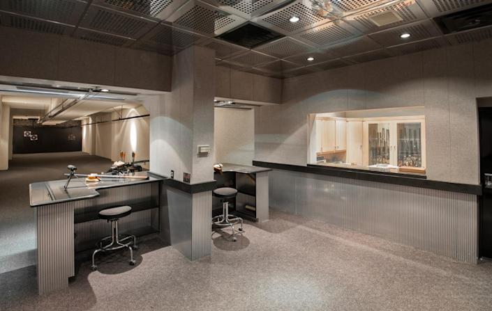 """<p>The underground, soundproofed shooting range could easily be converted to a music studio. We're thinking that might have been very attractive to Michael Jackson. (All photos via <a href=""""http://bit.ly/1OjQdjg"""" rel=""""nofollow noopener"""" target=""""_blank"""" data-ylk=""""slk:Concierge Auctions listing"""" class=""""link rapid-noclick-resp"""">Concierge Auctions listing</a>)</p>"""
