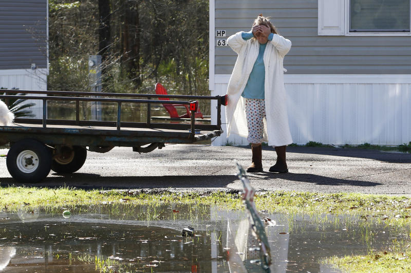 Donna Harvey reacts at having to evacuate from the Harbor Pines Mobile Home Community, Friday, Feb. 14, 2020., in Ridgeland, Miss., as flood waters began to encroach onto their property, The community is part of a subdivision that the Ridgeland mayor ordered to be evacuated Thursday evening. Officials estimate the flooding along the Pearl River to be the worst in Jackson and some neighboring communities since 1983. (AP Photo/Rogelio V. Solis)