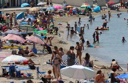 People cool off in the sea in Marseille as a heatwave hits much of the country