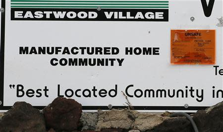 "A sign outside Eastwood Village indicates houses in the neighborhood as ""unsafe"" in Evans, Colorado"