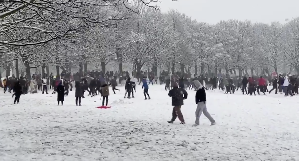 The huge snowball fight in Woodhouse Moor, in the Hyde Park area of Leeds, on Thursday. (Liam Ford/@ljfpics/Twitter)