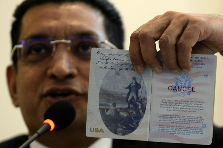 Lawyer Ali Sabry holds a document that is purportedly the cancelled US passport of Sri Lanka presidential candidate Gotabhaya Rajapakse