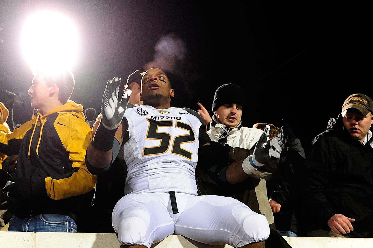 OXFORD, MS - NOVEMBER 23: Michael Sam #52 of the Missouri Tigers celebrates with fans following a victory over the Ole Miss Rebels at Vaught-Hemingway Stadium on November 23, 2013 in Oxford, Mississippi. Missouri won the game 24-10. (Photo by Stacy Revere/Getty Images)