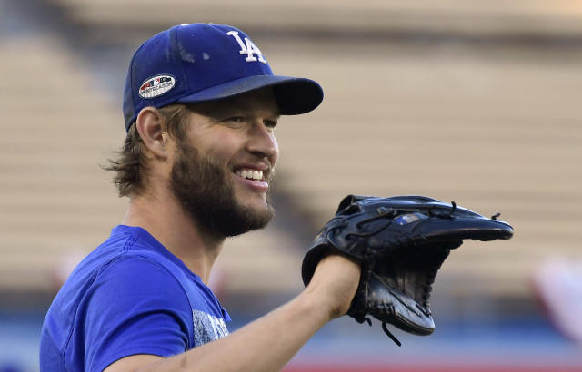 Los Angeles Dodgers starting pitcher Clayton Kershaw smiles as he warms up during practice for Game 1 of the baseball team's NLCS against the Milwaukee Brewers on Wednesday, Oct. 10, 2018, in Los Angeles. (AP Photo/Mark J. Terrill)