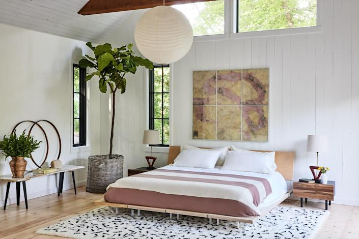 """<p>Set on a quiet street a few blocks from the ocean, a four-bedroom Montauk beach house by Manhattan-based interiors firm Studio Robert McKinley is a rare find—especially over Labor Day weekend when New Yorkers will be making their annual exodus from the city in pursuit of white sand beaches, lobster rolls from Sel Rrose, and one last opportunity for a natural tan.</p> <p>McKinley kept it simple and classic for the contemporary cottage, swathing the paneled walls in bright white paint, adding an appropriate amount of rattan and wicker decor, and a stylish collection of vintage pieces. For the home cooks, rest assured that the kitchen, fitted in Gaggenau appliances, is a chef's dream.</p> $6000, Airbnb. <a href=""""https://www.airbnb.com/rooms/51581465?"""" rel=""""nofollow noopener"""" target=""""_blank"""" data-ylk=""""slk:Get it now!"""" class=""""link rapid-noclick-resp"""">Get it now!</a>"""