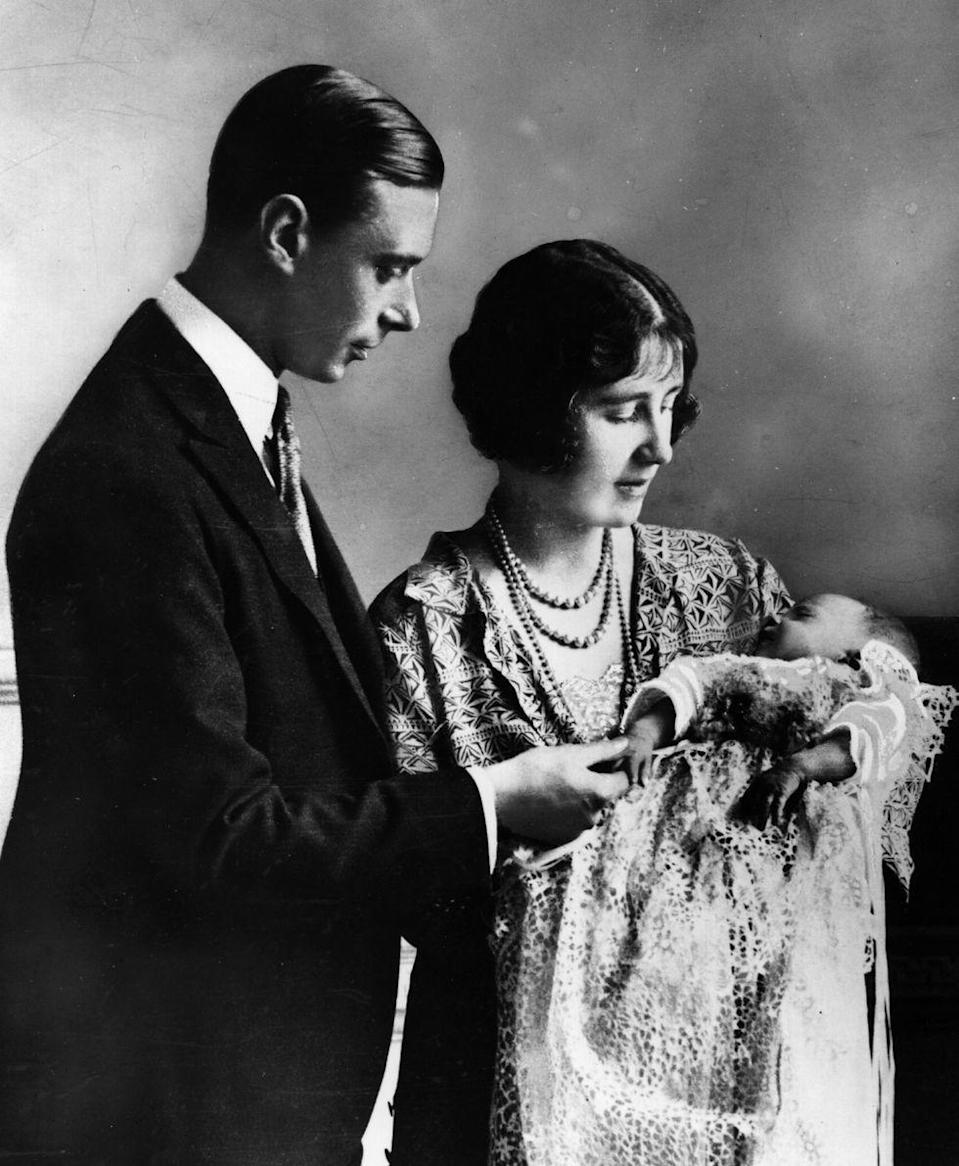 <p>King George V and Queen Mary's son, George, Duke of York (the future King George VI) and his wife Elizabeth, Duchess of York, welcomed their first child and future Queen, Princess Elizabeth on April 21, 1926. In this photo, the royal couple looks dotingly at their daughter at her christening a month after she was born.</p>