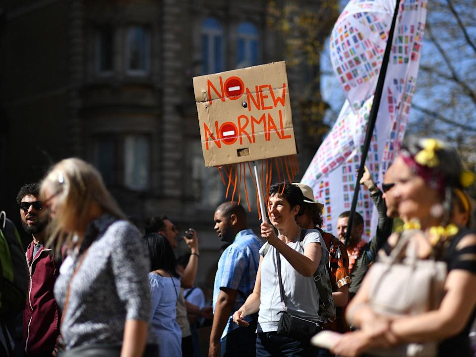 Demonstrators take part in an anti-lockdown, anti-Covid-19 vaccination passport protest in central London (AFP via Getty Images)