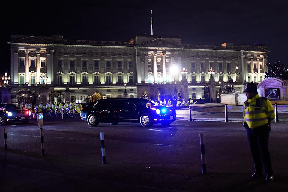 LONDON, ENGLAND - DECEMBER 03: U.S. President Donald Trump's convoy passes Buckingham Palace on day one of the NATO Leaders Summit on December 3, 2019 in London, England. France and the UK signed the Treaty of Dunkirk in 1947 in the aftermath of WW2 cementing a mutual alliance in the event of an attack by Germany or the Soviet Union. The Benelux countries joined the Treaty and in April 1949 expanded further to include North America and Canada followed by Portugal, Italy, Norway, Denmark and Iceland. This new military alliance became the North Atlantic Treaty Organisation (NATO). The organisation grew with Greece and Turkey becoming members and a re-armed West Germany was permitted in 1955. This encouraged the creation of the Soviet-led Warsaw Pact delineating the two sides of the Cold War. This year marks the 70th anniversary of NATO. (Photo by Peter Summers/Getty Images)